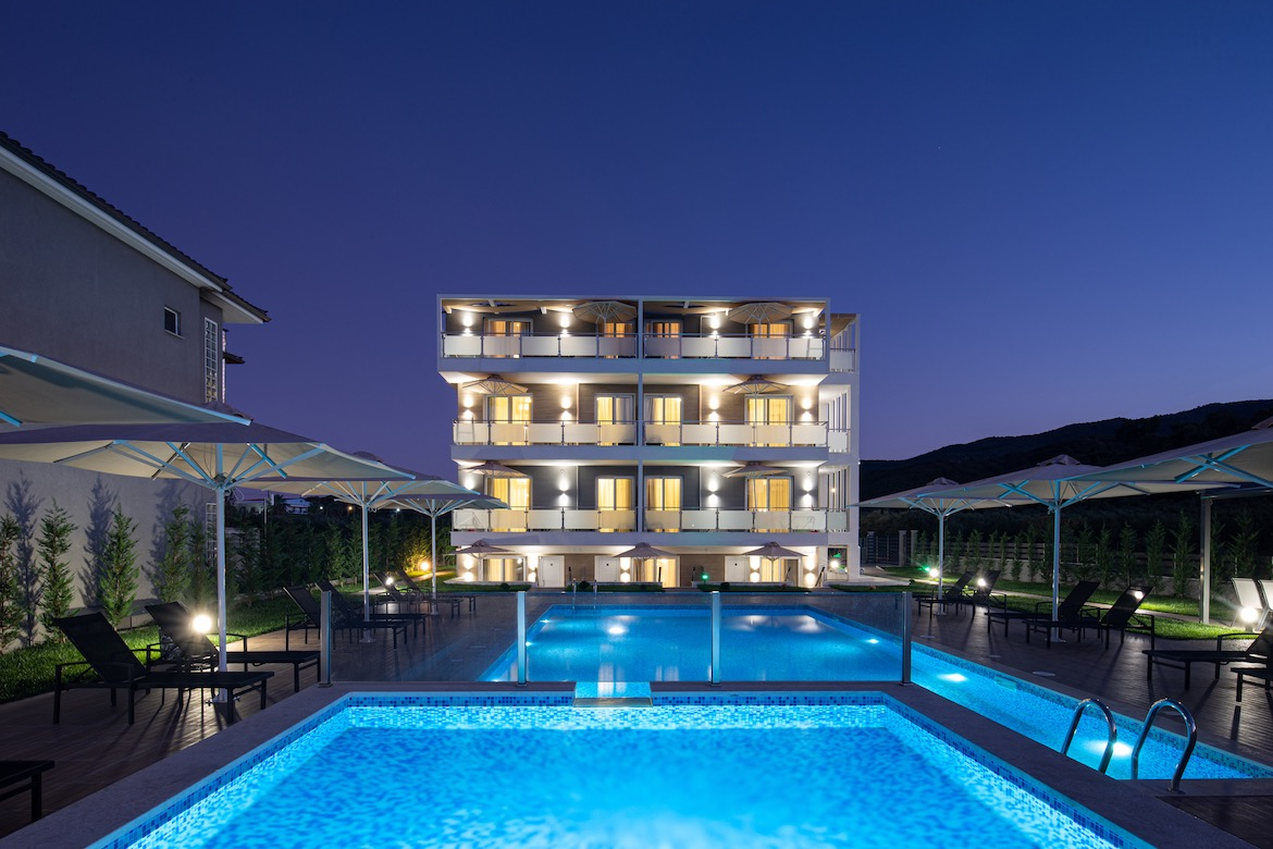 Astra Sarti Luxury Suites at night. Hotels in Sarti